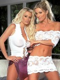 Two enchanting blondes demonstrate their big boobs and lick each other's oozing