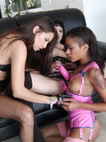There are three hot blooded lesbian chicks playing with sex toys like crazy