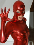 Sassy girl in the red spandex outfit has the extremely flexible body and willingly proves that