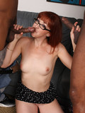 Four-eyed redhead gets double penetrated by black men in front of her white husband