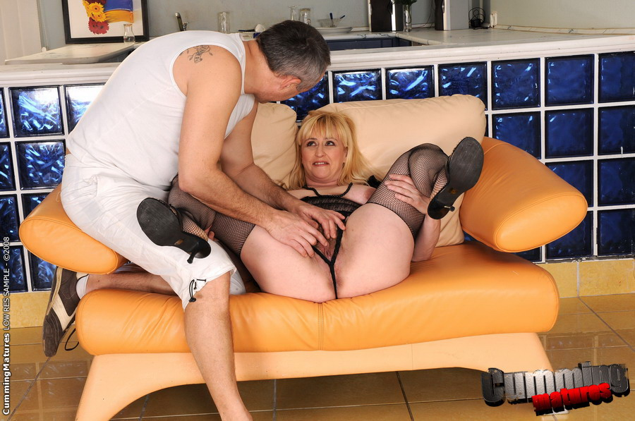 Mature stockings gets her mature pussy fingered