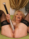 Blonde mom in black stockings fucks herself with baseball bat and gets fisted by brunette chick