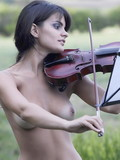 Cuddly babe with perky titties plays violin outdoors and slowly strips then spre