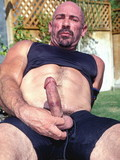 This sporty middle age man wants you to take a look at his rock solid cock