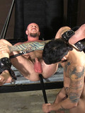 Hairy slave gets his asshole drilled by a cock and a dildo in the dungeon