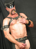 Middle aged gay man in leather smokes and jerks his amazing pierced cock