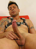 Hot tattooed gay man in boots gives a closeup view of his snake shamelessly