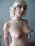 Blonde with delicious tits and sexy well shaped ass poses nude and shows her piercing