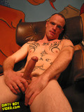 Dirty gay boy with tattoos all over his body demonstrates the hard piston
