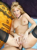Slutty blue eyed blonde in black stockings gets her anal hole screwed hard