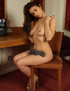 Hot bodied brunette Katie demonstrates her perfect natural tits sitting on a chair