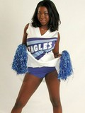 Black cheerleader stretching and gladly showing her shaved puffy pussy