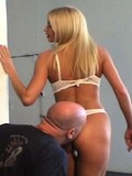 Long haired stacked blonde in snow white lingerie smothers man with her butt