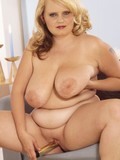 Bulky blonde lady demonstrates her massive tits and dildos her thirsty pussy