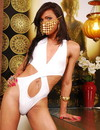 Slim transsexual seductress with flat chest and long brunette hair strips shyly