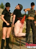 Nude man gets mercilessly punished by two rude military ladies outdoors