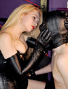 Blonde domme in black makes her slave boy worship her boots and rides him