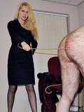 Middle aged man gets undressed and whipped by clothed blonde dominatrix