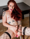 Small titted redhead tranny in fishnet stockings shows off her shaved cock