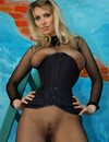 Big meloend woman in see through body stocking wears ultra tight corset