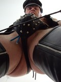 Dirty gay man in leather outfit pumps his cock eager to make it hard and big
