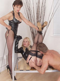 Lady in garters examines her lad