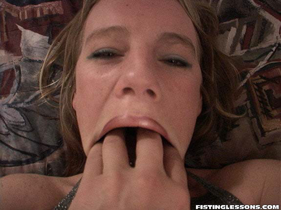 Fingers in her mouth