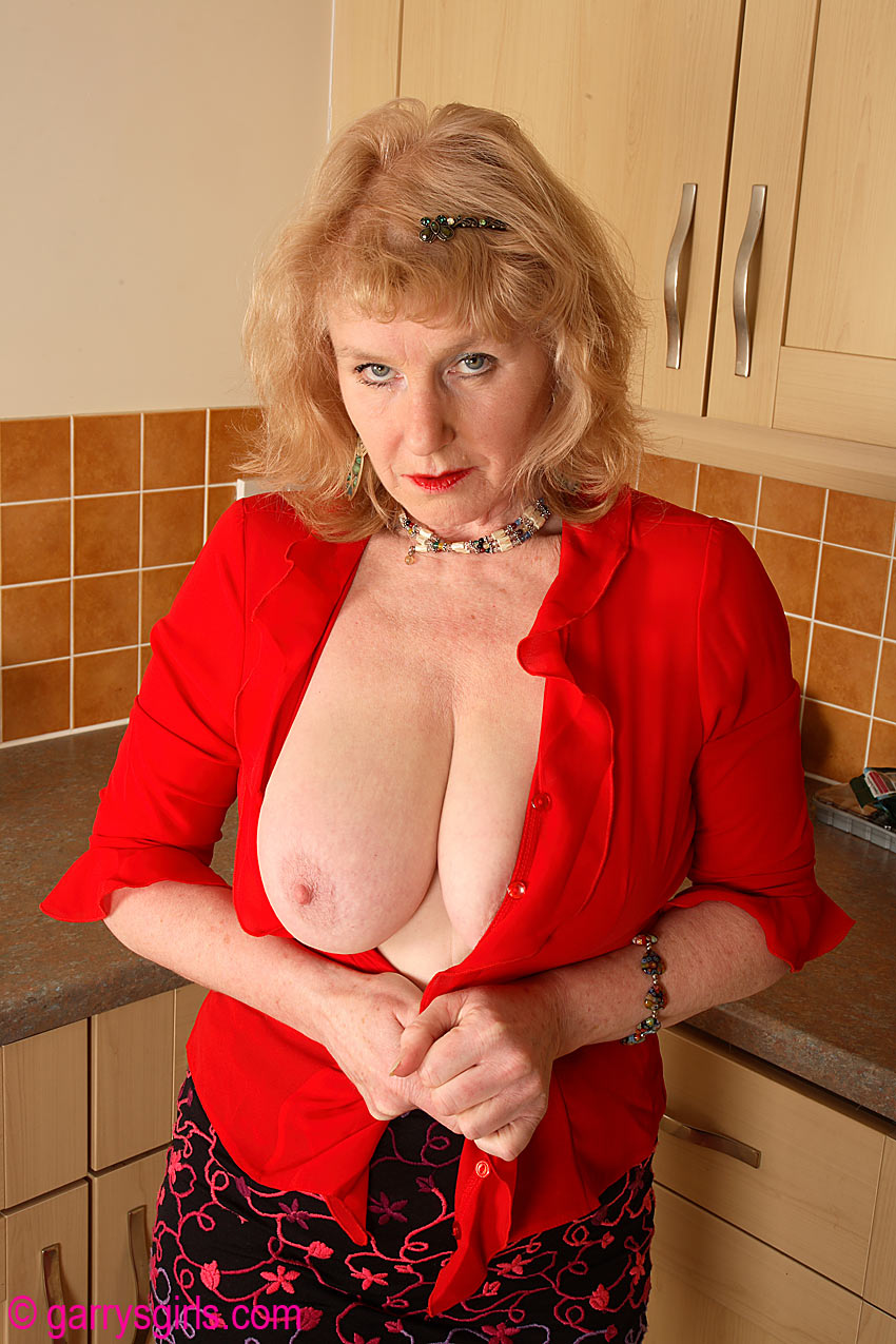 aged woman in pink pantyhose displays her big knockers and nice