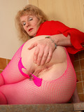 Aged woman in pink pantyhose displays her big knockers and nice mature pussy