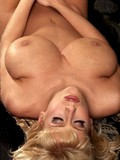 Deliciously sexy fully nude blonde demonstrates her giant melons and sexy muff