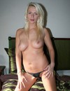 Topless amateur blonde in black thong panties is proud of her massive firm boobs