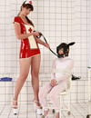 Chick in white gets tied up and used by  sexy giantess in nurse uniform