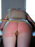 Schoolgirls with perfectly shaped asses get naked and take some spanking