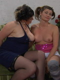 Chubby mature lady with big natural tits has unforgettable lesbian sex with pigtailed girl