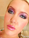 Round assed babe with rich make-up gives a close-up view of her pink love hole