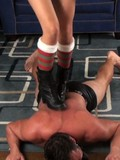 Topless guy gets trampled by dark haired domina in high socks and short boots