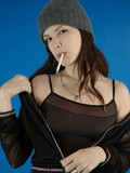 Bare sweetie in a cap hot posing and smoking