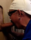 Lucky gay guy gets his stiff dick sucked nicely by a gay dude at a gloryhole