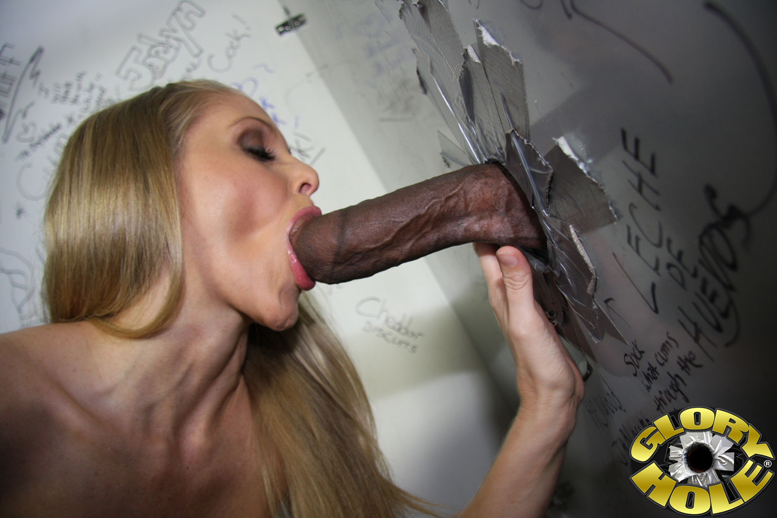 Busty Pronstar Babe Sucking Huge Dick Through Glory Hole