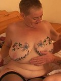 Inked up chubby oldie takes hard mature cock in her horny pierced pussy