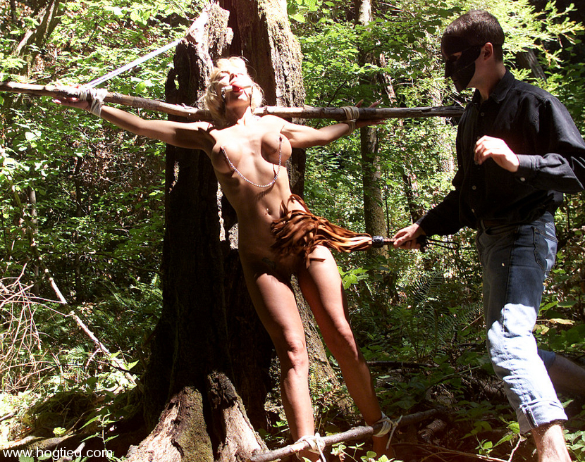 Tied up to a tree and offered gay porn photo on mistermale