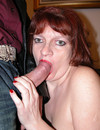 Mature redhead woman in black stockings takes stiff dick up her horny pussy