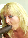 Fair haired granny in skirt gets her mouth and loose pussy drilled with black cock