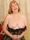 Sexy dressed playful granny Trisha plays with her breasts and flashes her twat