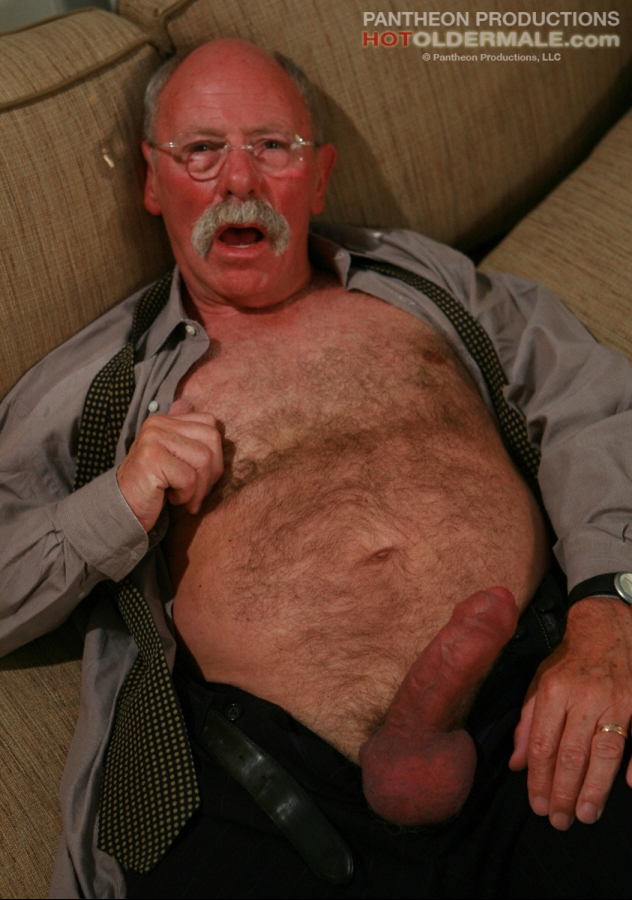 Hairy chested elderly man in glasses gets naked and strokes hard good size  cock