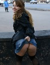 Playful Russian chick in jean mini skirt flashes her shaved snatch in public
