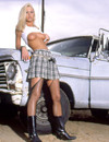 Blonde in skirt and stockings shows her shaved snatch in her pick-up truck