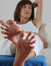 Brunette in white Katherina shows off her long toes with beautiful red toenails
