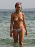 Free babes topless on seashore