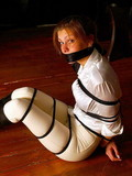 Bound and gagged slut laying helpless on the floor